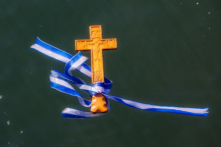 Thessaloniki, January 6, 2018: close-up a wooden cross in the sea, at the blessing of the water ceremony marking the Orthodox Epiphany, at the harbor of Thessaloniki Editorial
