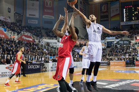 Thessaloniki, Greece, January 7, 2018: Player of Olympiacos Jamel Mclean (L) and player of PAOK Linos Chrysikopoulos (R) in action during the Greek Basket League game Paok vs Olympiacos in Paok Sports Arena Stadium Редакционное