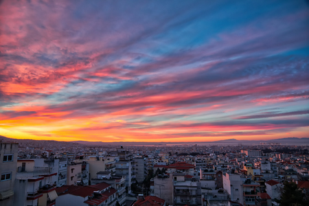 sunrise over the buildings in a neighborhood of the city of Thessaloniki