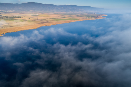 Aerial View. Flying over the clouds . Aerial camera shot. Landscape panorama.