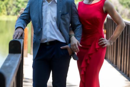 Beautiful mature couple standing near lake