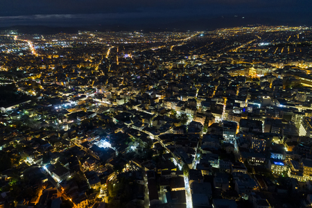 Aerial view of Athens city at night, Greece. Image taken with action drone camera