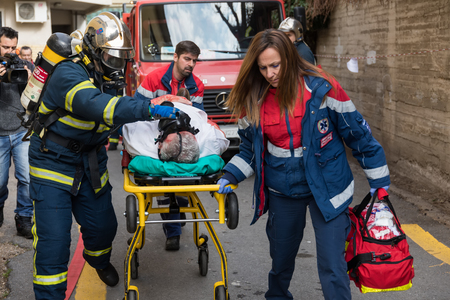 Thessaloniki, Greece - Feb 16, 2018: Salvation crews evacuate patients and injured in hospital AXEPA during exercise for earthquake