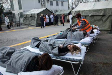 Thessaloniki, Greece - Feb 16, 2018: patients have been transferred to an open-air hospital during an earthquake training session at the AXEPA hospital