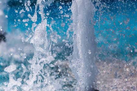 The gush of water of a fountain. Splash of water in the fountain, abstract image Stock Photo