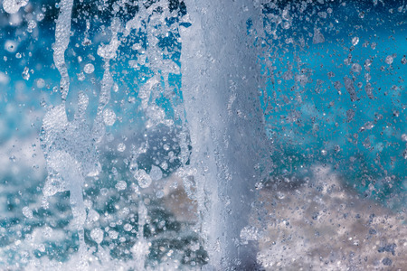 The gush of water of a fountain. Splash of water in the fountain, abstract image Standard-Bild