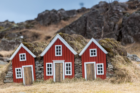 Traditional Icelandic Turf Houses. A row of traditional Icelandic houses with the roofs covered in turf for insulation.