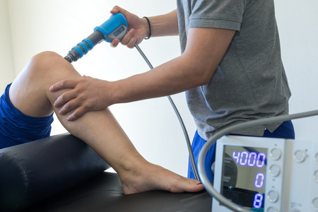 physical therapy of the knee and the foot with shock wave