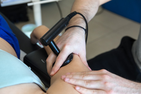 Physiotherapist doing Tecar therapy (Radio Frequency Transporter) alterantive treatment on a woman patient