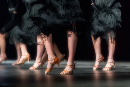 Legs of young dancers on the dance floor  Stock Photo