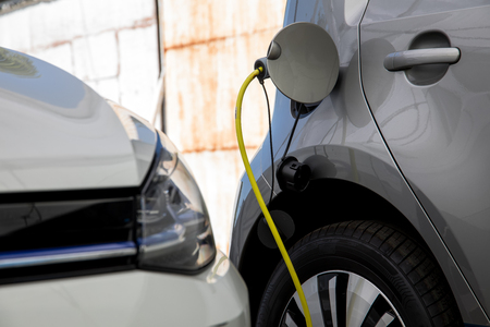 Electric car refuel with power Stock Photo