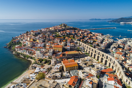 Aerial view the city of Kavala in northern Greek, ancient aqueduct Kamares, homes and medieval city wall  Stock fotó