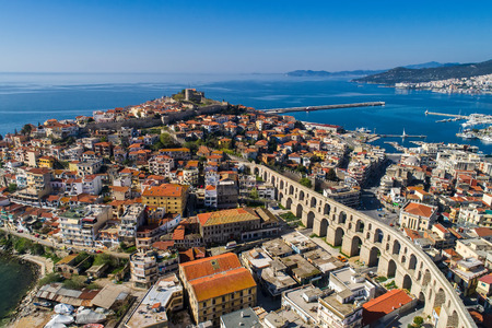 Aerial view the city of Kavala in northern Greek, ancient aqueduct Kamares, homes and medieval city wall  Stock Photo