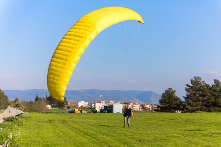 Drama, Greece -  April 8, 2018: a man is trained on a paragliding flight in the popular area for parachuting on the side of Korylovou in drama Editorial