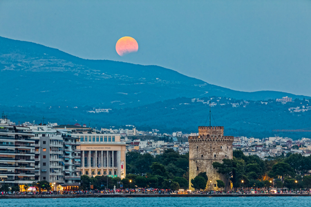Thessaloniki, Greece -  August 7, 2017: Full Blood Moon and Eclipse Oven White Tower of Thessaloniki, Greece Editorial