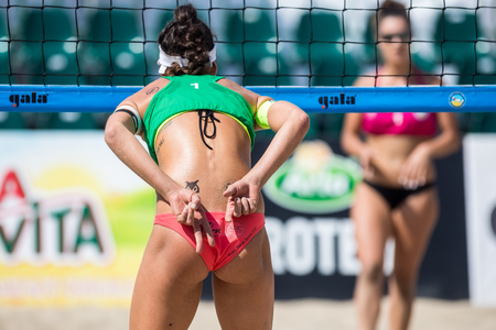 Thessaloniki -Greece June 8,2018:close up of woman buttocks and hands showing beach volleyball hand sign meaning angle attack block during the Hellenic championship Masters 2018 at Aristotelous square