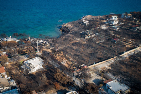Mati, Athens - July 26, 2018: Aerial view shows a burnt area following a wildfire in the village of Mati, near Athens. Wildfires occurred on the 23 of July , left for the moment 92 people dead.