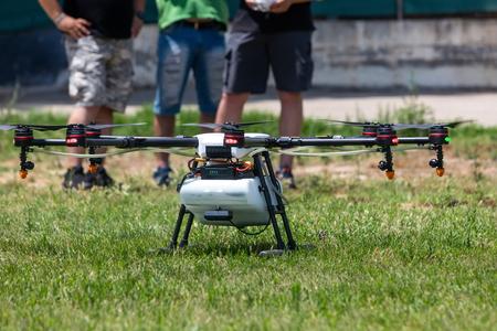 Thessaloniki, Greece - June 21, 2018: Professional agriculture drone on the green field during pre-flight preparation Standard-Bild - 114503904