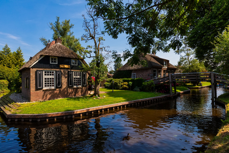 Giethoorn, Netherlands - July 4, 2018: view of famous village Giethoorn with canals in the Netherlands. Giethoorn is also called 'Venice of The Netherlands'