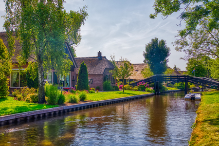 Giethoorn, Netherlands - July 4, 2018: view of famous village Giethoorn with canals in the Netherlands. Giethoorn is also called Venice of The Netherlands