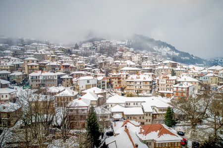 Aerial view of the snowy Metsovo is a town in Epirus, in the mountains of Pindus in northern Greece and attracts many visitors Фото со стока