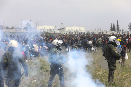 Thessaloniki, Greece - April 5, 2019: Migrants clashes with Greek riot police outside of a refugee camp in Diavata. Migrants and refugees gathered to walk to the border of Greece to pass to Europe Editorial