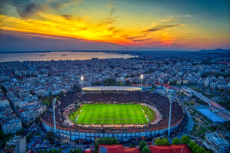 Thessaloniki, Greece, April 21, 2019: Aerial shoot of the Toumba Stadium full of fans of PAOK celebrating the winning of the Greek Super League championship title. Stok Fotoğraf - 123455664
