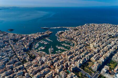 Aerial drone panoramic photo of Piraeus and Marina of Zea (pasalimani) in daylight, Attica, Greece.