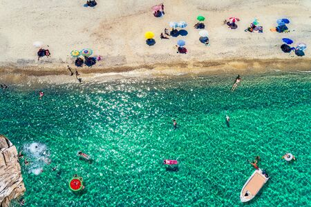 Top view of people enjoying the beach at Chalkidiki, Greece.