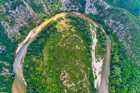 Aerial view of the river Nestos in Xanthi, Greece. The Nestos River forms on its long journey landscapes of unique beauty with rich forests, rare wetlands. favorite destination for canoe and kayak