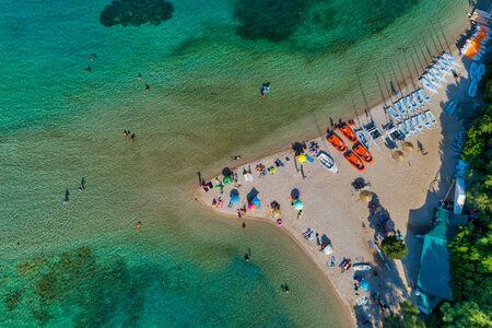 Aerial drone bird's eye view of Bella Vraka Beach with turquoise sea in complex islands in Sivota area, Ionian sea, Epirus, Greece