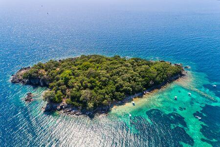 Aerial view of uninhabited island near of Agia Paraskeui Beach with turquoise sea in Parga area, Ionian sea, Epirus, Greece Stock Photo