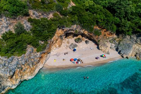 Aerial drone bird's eye view of of Small Drafi Beach with turquoise sea in Parga area, Ionian sea, Epirus, Greece Stock Photo