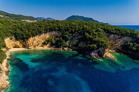 Aerial drone bird's eye view of of Mega Drafi Beach with turquoise sea in Parga area, Ionian sea, Epirus, Greece