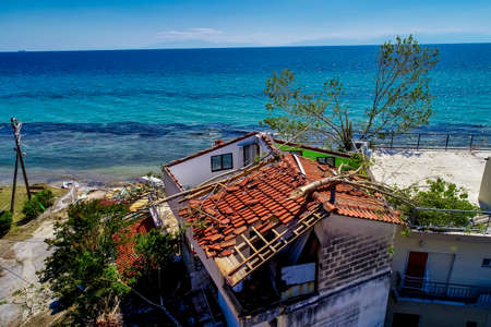 Nea Plagia, Chalkidiki, Greece - July 10, 2019: aerial photography of the damaged roofs of houses in Nea Plagia after a storm and tornadoes
