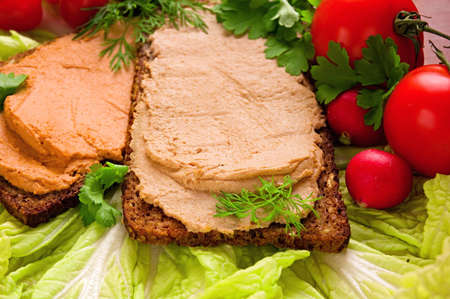 Sandwiches with pate, fresh vegetables and herbs.