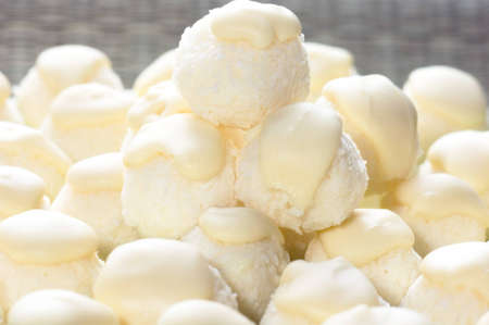 coconut sugar: Handmade coconut balls topped with white chocolate. Shallow DOF Stock Photo