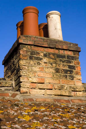 english house: Chimneys on typical english house.