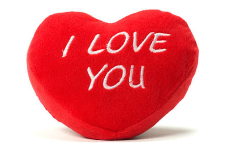 red pillows: I love you - soft valentine heart shaped cushion isolated on white background.