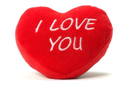 wishes romantic: I love you - soft valentine heart shaped cushion isolated on white background.