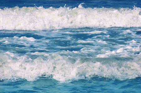 Blue sea waves on sunny summer day.