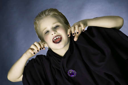 Boy dressed up as a vampire for Halloween party photo