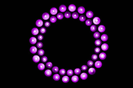 Ring of purple LED lights on black background photo