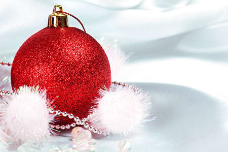 One red Christmas bauble on silk background. photo