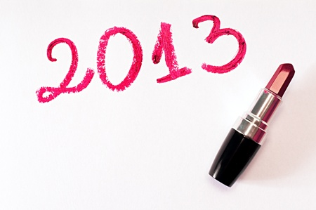 2013 written with red lipstick on white paper background Stock Photo