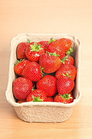 Fresh ripe strawberries in a punnet