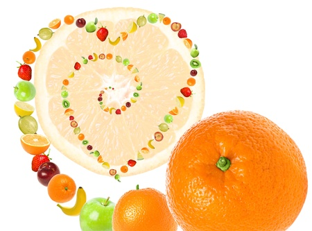 Fruit abstract imaging love to fruits and healthy diet. Line of juicy fruits forming swirl and heart shape on white background.