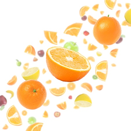 multivitamin: Cloud of many flying fruits on white background with oranges in foreground