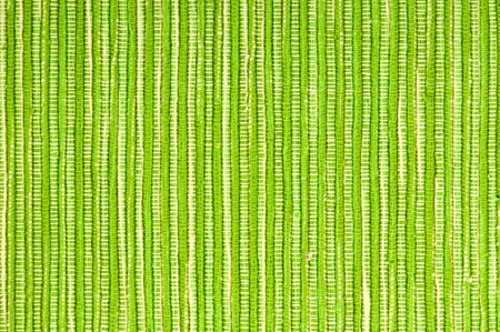 Green striped cotton fabric background, rough texture