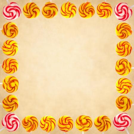 Frame made of vintage swirl, lollipops on vintage background.